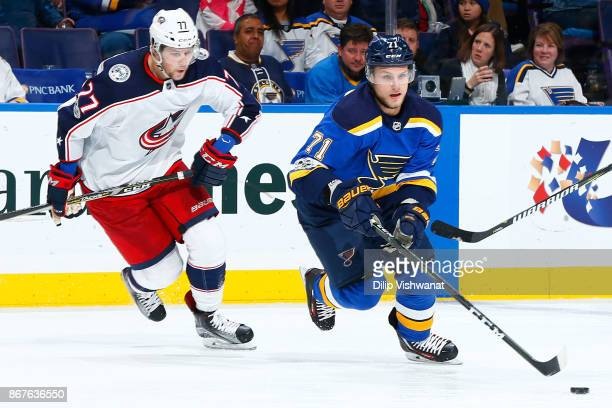 Vladimir Sobotka of the St Louis Blues controls the puck against Josh Anderson of the Columbus Blue Jackets at Scottrade Center on October 28 2017 in...
