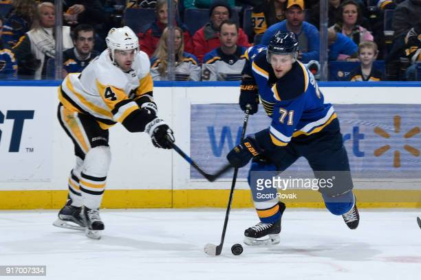 Vladimir Sobotka of the St Louis Blues controls the puck as Justin Schultz of the Pittsburgh Penguins defends at Scottrade Center on February 11 2018...