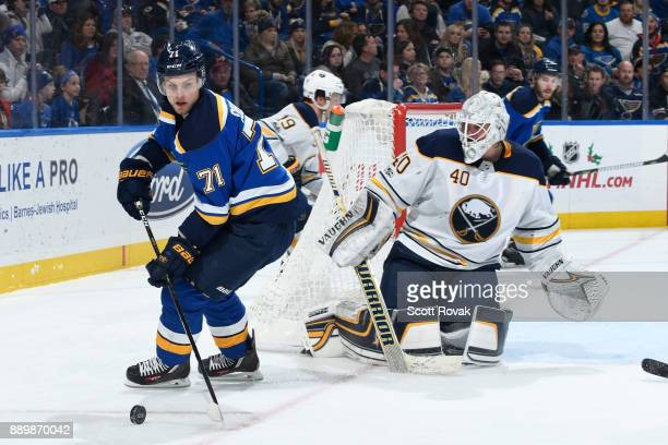 Vladimir Sobotka of the St Louis Blues controls the puck in front of Robin Lehner of the Buffalo Sabres at Scottrade Center on December 10 2017 in St...