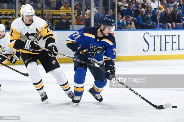 Vladimir Sobotka of the St Louis Blues handles the puck as Evgeni Malkin of the Pittsburgh Penguins adds pressure at Scottrade Center on February 11...