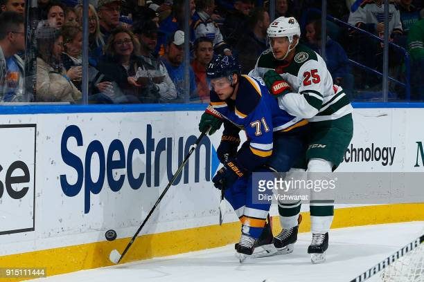 Vladimir Sobotka of the St Louis Blues looks to beat Jonas Brodin of the Minnesota Wild to the puck at Scottrade Center on February 6 2018 in St...