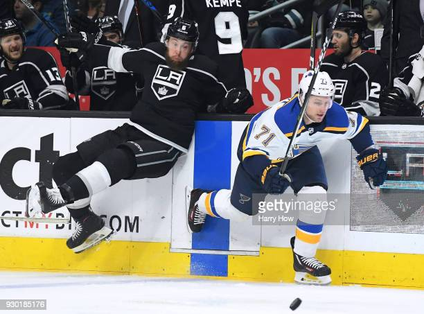 Vladimir Sobotka of the St Louis Blues misses a check from Jake Muzzin of the Los Angeles Kings during the first period at Staples Center on March 10...