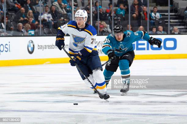 Vladimir Sobotka of the St Louis Blues skates with the puck against Timo Meier of the San Jose Sharks at SAP Center on March 8 2018 in San Jose...