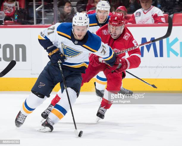 Vladimir Sobotka of the St Louis Blues skates with the puck followed by Justin Abdelkader of the Detroit Red Wings during an NHL game at Little...