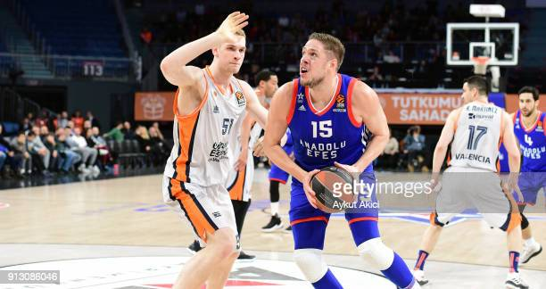 Vladimir Stimac #15 of Anadolu Efes Istanbul competes with Tryggvi Snaer Hlinason #51 of Valencia Basket during the 2017/2018 Turkish Airlines...