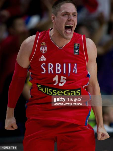 Vladimir Stimac of Serbia celebrates their victory against France after the 2014 FIBA World Basketball Championship semifinal match between France...