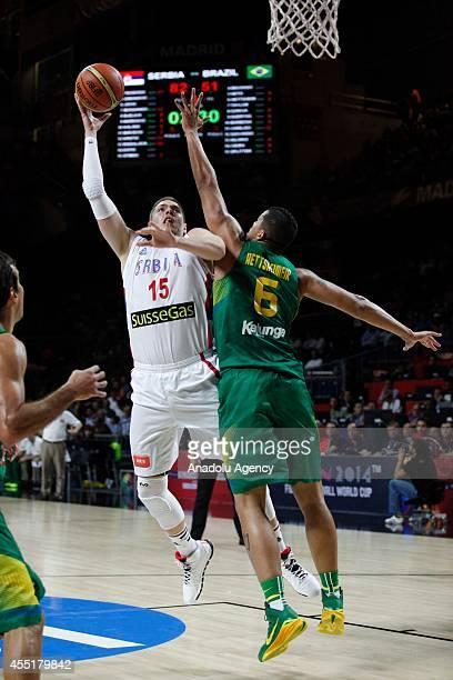 Vladimir Stimac of Serbia in action against Rafael Hettsheimeir of Brazil during the 2014 FIBA Basketball World Cup quarter final match between...