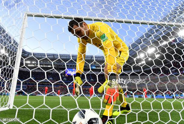 Vladimir Stojkovic goalkeeper of Serbia picks the ball out of the back of the net after Granit Xhaka of Switzerland scores his sides opening goal to...