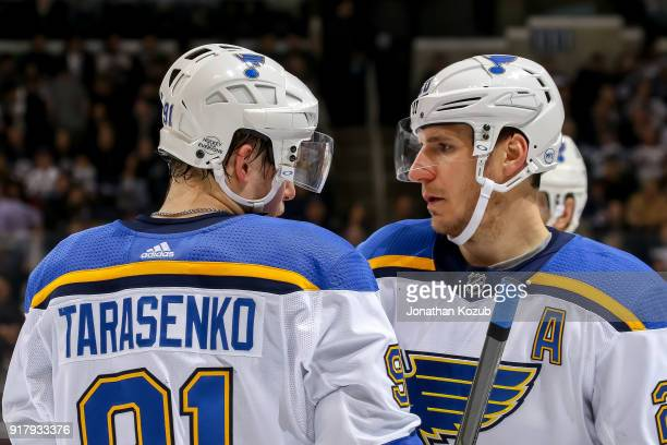Vladimir Tarasenko and Alexander Steen of the St Louis Blues discuss strategy during a first period stoppage in play against the Winnipeg Jets at the...