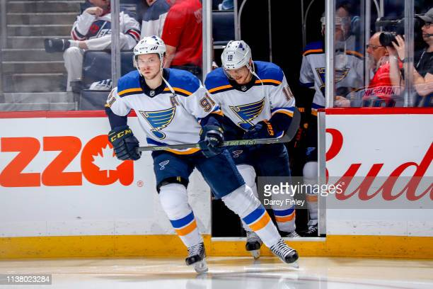 Vladimir Tarasenko and Brayden Schenn of the St Louis Blues hits the ice prior to puck drop for second period action against the Winnipeg Jets in...