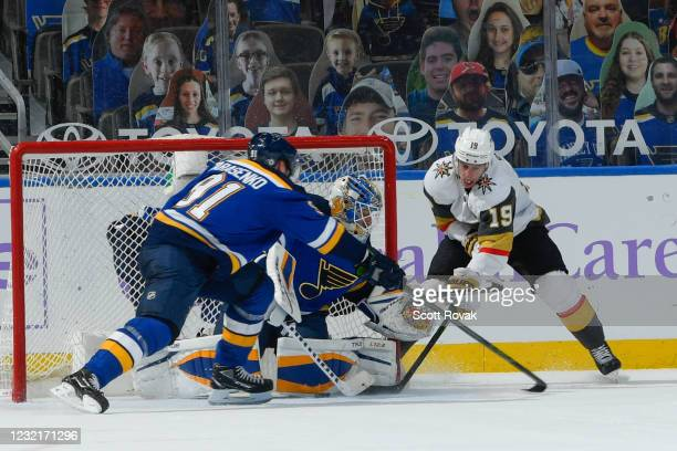 Vladimir Tarasenko and Jordan Binnington of the St. Louis Blues defend the net against Reilly Smith of the Vegas Golden Knights on April 7, 2021 at...