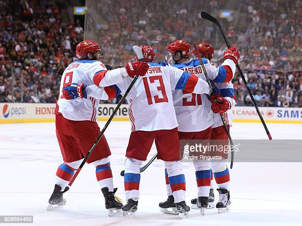 Vladimir Tarasenko celebrates with Alex Ovechkin and Pavel Datsyuk of Team Russia after scoring a second period goal on Team North America during the...