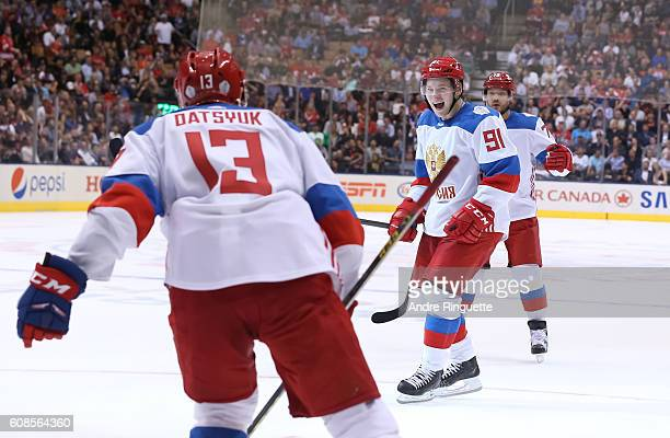 Vladimir Tarasenko celebrates with Pavel Datsyuk of Team Russia after scoring a second period goal on Team North America during the World Cup of...