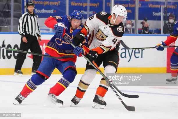 Vladimir Tarasenko of the St. Louis Blues and Isac Lundestrom of the Anaheim Ducks fight for control of the puck in the first period at Enterprise...