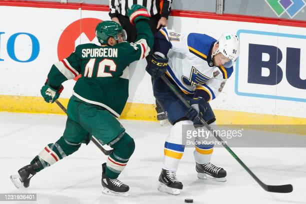 Vladimir Tarasenko of the St. Louis Blues and Jared Spurgeon of the Minnesota Wild battle for the puck during the game at the Xcel Energy Center on...