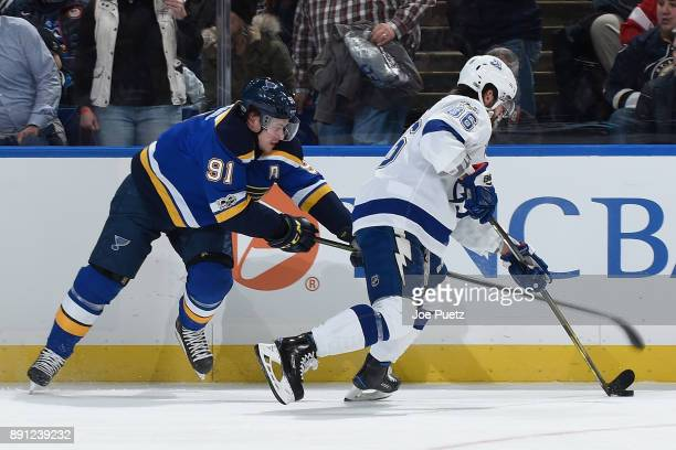 Vladimir Tarasenko of the St Louis Blues and Nikita Kucherov of the Tampa Bay Lightning battle for the puck at Scottrade Center on December 12 2017...