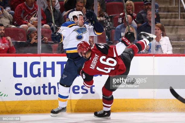 Vladimir Tarasenko of the St Louis Blues and Trevor Murphy of the Arizona Coyotes collide during the second period of the NHL game at Gila River...