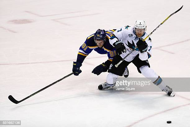 Vladimir Tarasenko of the St Louis Blues battles for the puck with Paul Martin of the San Jose Sharks during the third period in Game One of the...