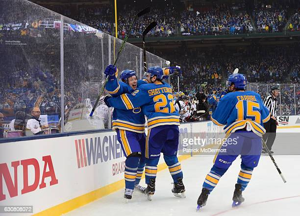 Vladimir Tarasenko of the St Louis Blues celebrates his goal against the Chicago Blackhawks with teammates Kevin Shattenkirk and Robby Fabbri during...