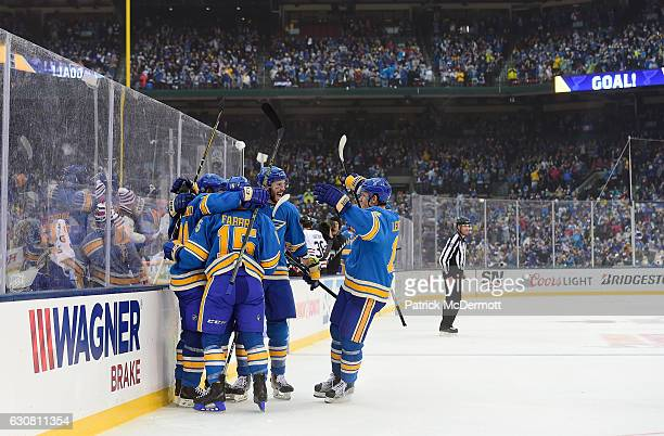 Vladimir Tarasenko of the St Louis Blues celebrates his goal against the Chicago Blackhawks with teammates Joel Edmundson Kevin Shattenkirk and Robby...