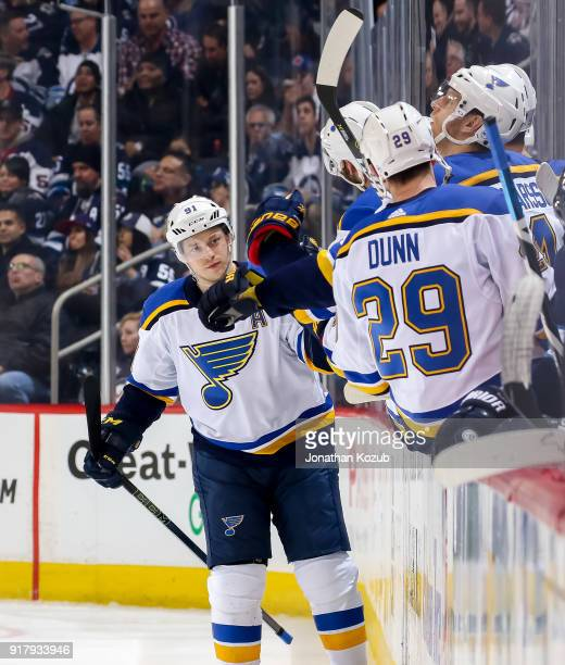 Vladimir Tarasenko of the St Louis Blues celebrates his second period goal against the Winnipeg Jets with teammates at the bench at the Bell MTS...