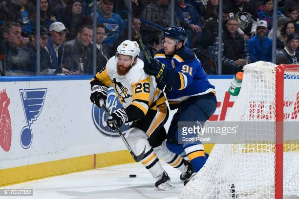 Vladimir Tarasenko of the St Louis Blues checks Ian Cole of the Pittsburgh Penguins at Scottrade Center on February 11 2018 in St Louis Missouri
