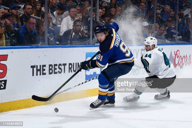 Vladimir Tarasenko of the St. Louis Blues controls the puck as Marc-Edouard Vlasic of the San Jose Sharks defends in Game Four of the Western...