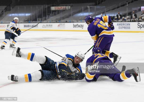 Vladimir Tarasenko of the St. Louis Blues falls to the ice with Sean Walker of the Los Angeles Kings during a 4-1 Kings win at Staples Center on...