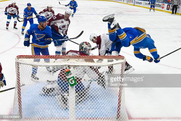 Vladimir Tarasenko of the St. Louis Blues gets checked by Tyson Jost of the Colorado Avalanche on April 24, 2021 at the Enterprise Center in St....