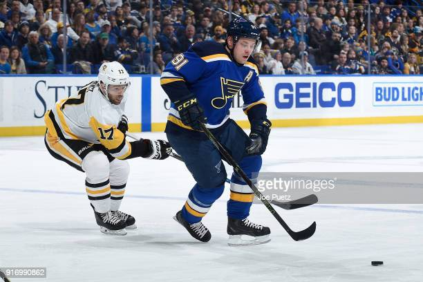 Vladimir Tarasenko of the St Louis Blues handles the puck as Bryan Rust of the Pittsburgh Penguins pressures at Scottrade Center on February 11 2018...