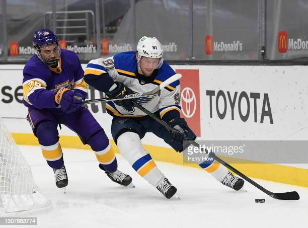 Vladimir Tarasenko of the St. Louis Blues is chased by Sean Walker of the Los Angeles Kings during a 4-1 Kings win at Staples Center on March 17,...