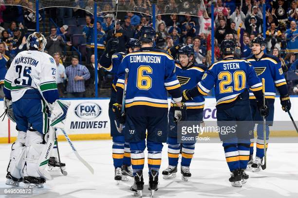 Vladimir Tarasenko of the St Louis Blues is congratulated b y teammates after scoring against Jacob Markstrom of the Vancouver Canucks on February 16...