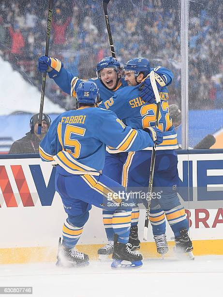 Vladimir Tarasenko of the St Louis Blues is congratulated by Robby Fabbri and Kevin Shattenkirk of the St Louis Blues after scoring a goal against...