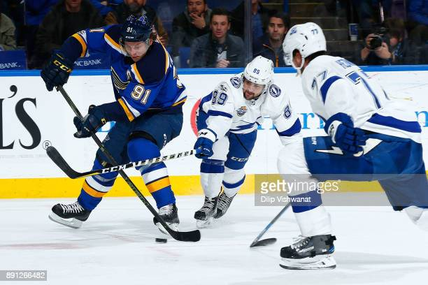 Vladimir Tarasenko of the St Louis Blues looks to take a shot on goal against Cory Conacher of the Tampa Bay Lightning at Scottrade Center on...