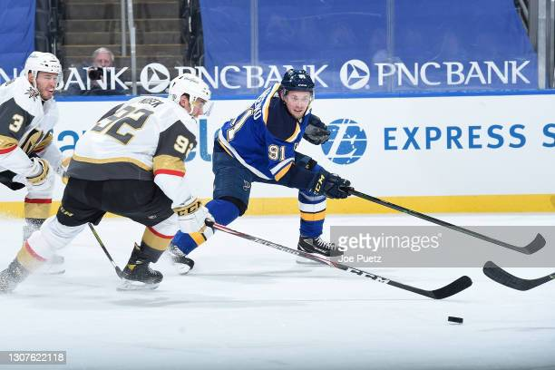 Vladimir Tarasenko of the St. Louis Blues pressures Tomas Nosek of the Vegas Golden Knights on March 12, 2021 at the Enterprise Center in St. Louis,...
