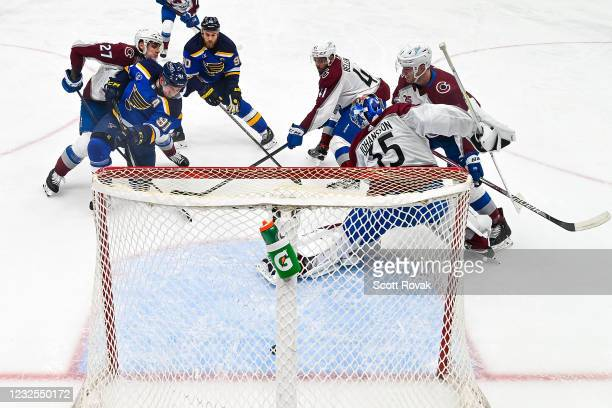 Vladimir Tarasenko of the St. Louis Blues scores a goal as Ryan Graves Pierre-Edouard Bellemare Tyson Jost and Jonas Johansson of the Colorado...