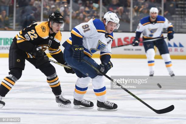 Vladimir Tarasenko of the St Louis Blues skates after the puck against Peter Cehlarik of the Boston Bruins at the TD Garden on February 1 2018 in...