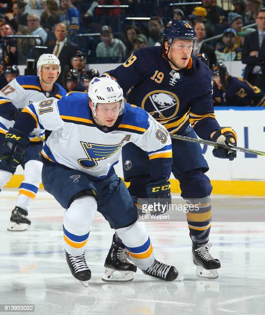 Vladimir Tarasenko of the St Louis Blues skates with Jake McCabe of the Buffalo Sabres during the second period of an NHL game on February 3 2018 at...