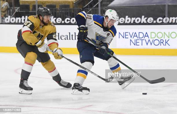 Vladimir Tarasenko of the St. Louis Blues skates with the puck against Shea Theodore of the Vegas Golden Knights in the third period of their game at...