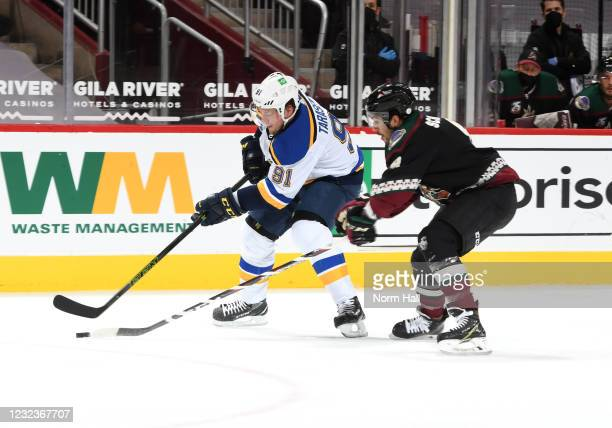 Vladimir Tarasenko of the St Louis Blues skates with the puck as Nick Schmaltz of the Arizona Coyotes defends during the first period of the NHL...