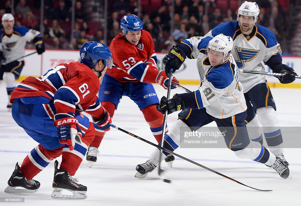 Vladimir Tarasenko #91 of the St. Louis Blues slaps a shot while being challenged by Ryan White #53 and Raphael Diaz #61 of the Montreal Canadiens during the NHL game on November 5, 2013 at the Bell Centre in Montreal, Quebec, Canada.