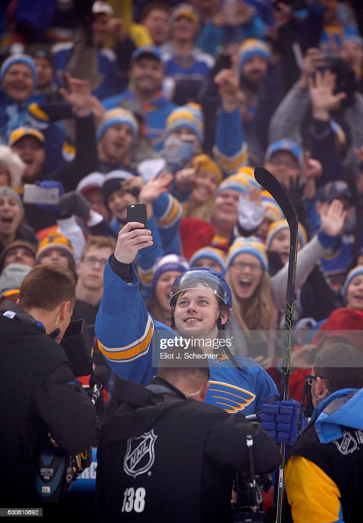 Vladimir Tarasenko #91 of the St. Louis Blues takes a selfie photo with the fans after the 2017 Bridgestone NHL Winter Classic at Busch Stadium on January 2, 2017 in St Louis, Missouri. The Blues defeated the Blackhawks 4-1.