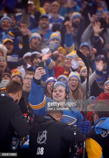 Vladimir Tarasenko of the St Louis Blues takes a selfie photo with the fans after the 2017 Bridgestone NHL Winter Classic at Busch Stadium on January...