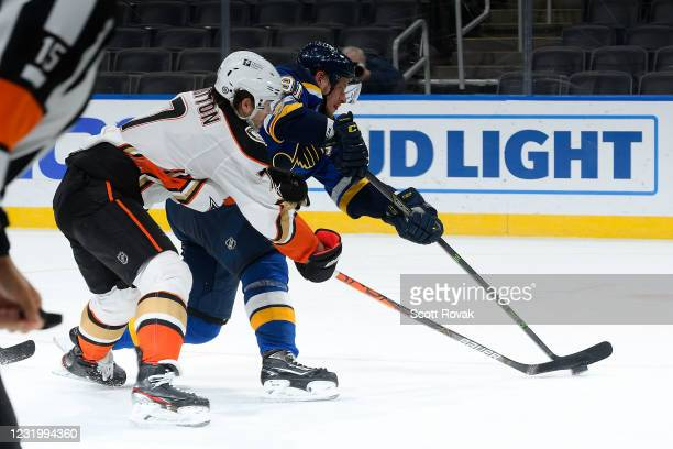 Vladimir Tarasenko of the St. Louis Blues takes a shot as Ben Hutton of the Anaheim Ducks defends on March 28, 2021 at the Enterprise Center in St....