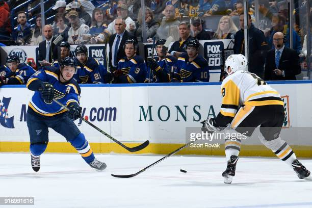 Vladimir Tarasenko of the St Louis Blues takes a shot as Brian Dumoulin of the Pittsburgh Penguins defends at Scottrade Center on February 11 2018 in...