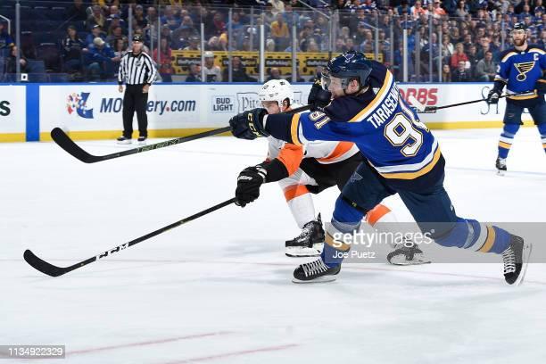 Vladimir Tarasenko of the St Louis Blues takes a shot as Corban Knight of the Philadelphia Flyers attempts to block at Enterprise Center on April 4...