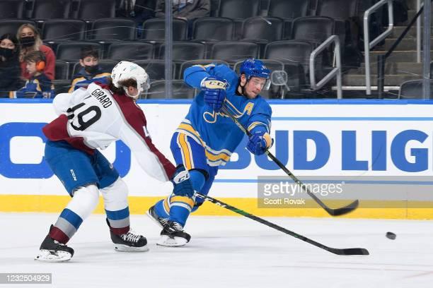 Vladimir Tarasenko of the St. Louis Blues takes a shot as Samuel Girard of the Colorado Avalanche defends on April 24, 2021 at the Enterprise Center...