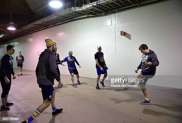 Vladimir Tarasenko of the St Louis Blues warms up in the hallway kicking a soccer ball with teammates prior the 2017 Bridgestone NHL Winter Classic...