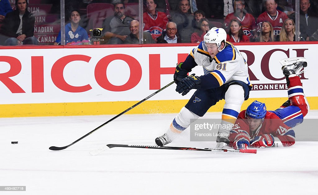 Vladimir Tarasenko #91 of the St-Louis Blues controls the puck against Alexei Emelin #74 of the Montreal Canadiens in the NHL game at the Bell Centre on October 20, 2015 in Montreal, Quebec, Canada.