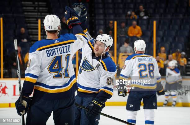 Vladimir Tarasenko skating in his 400th NHL game high fives Robert Bortuzzo of the St Louis Blues during warmups prior to a game against the...